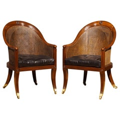 Pair of Regency Period Mahogany and Caned Library Bergeres