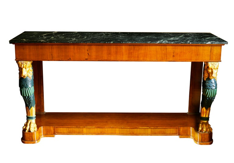 A stunning set of grand midcentury consoles with large lion supports in the style of George Smith. These classical tables take their inspiration from the French Empire and English Regency designers that infused their work with an