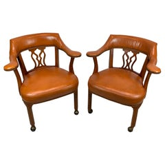 Pair of Regency Style Saddle Leather Captains Chairs