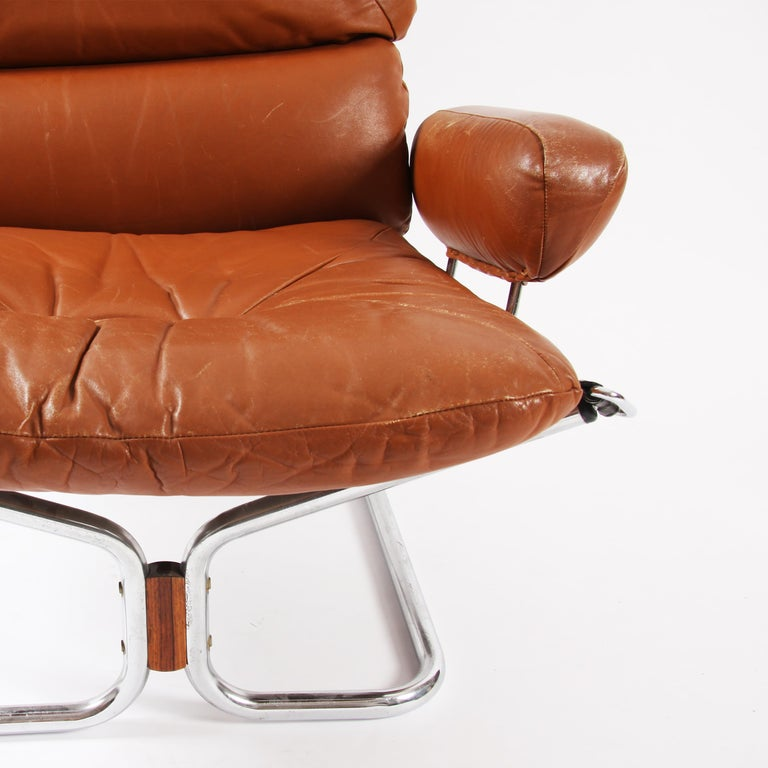 Mid-Century Modern Pair of Relling Chairs For Sale