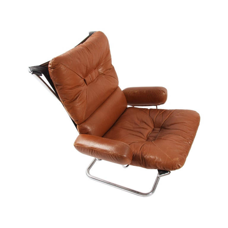 Leather Pair of Relling Chairs For Sale