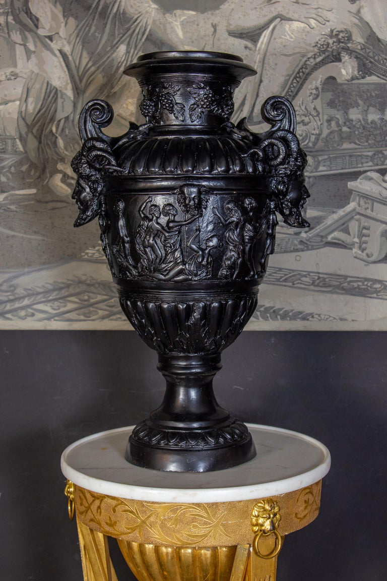 Impressive pair of black patinated bronze vases in the style of Renaissance. Finely decorated handles with a satyr figure, over with a and body surrounded by bacchanal scenes. Exquisite decoration for your interior or garden.