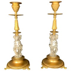 Pair of Renaissance Revival Part-Silvered Bronze Candlesticks