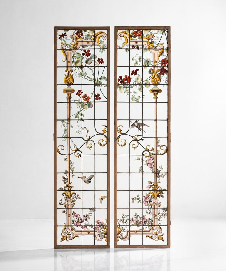 Pair of Renaissance Revival shutters, France, circa 1900  Intricate hand painted garden motif on glass panes with iron supports in original wooden shutters.