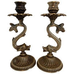 Pair of Repoussé Brass Dolphin Candlesticks
