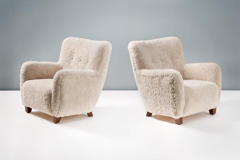 A pair of custom-made armchairs based on the Danish Modern styles of the 1940-50s.   These high-end productions are handmade to order at our workshops in England. The chair legs are available in oiled walnut, oiled oak or polished stained beechwood.