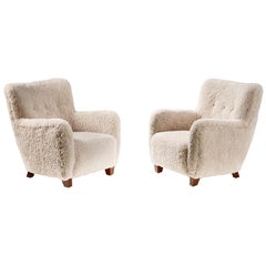 Pair of Reproduction 1950s Sheepskin Armchairs and Ottomans