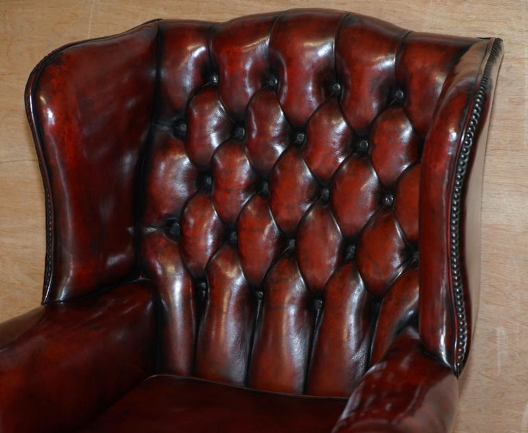 Pair of Restored Claw & Ball Chesterfield Wingback Bordeaux Leather Armchairs In Good Condition For Sale In London, GB