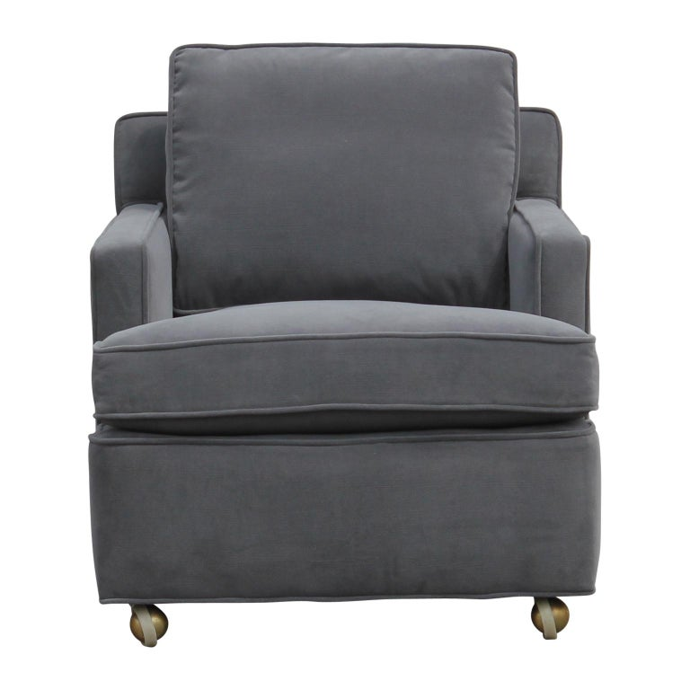 Recently reupholstered and restored pair of lounge chairs and ottman from Dunbar Furniture by Edward Wormley. These chairs from the 1950s are now covered in Kravet velvet and very comfortable. They have castors on the bottom of the chairs and