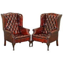Pair of Restored Oxblood Leather Fully Tufted Chesterfield Wingback Armchairs