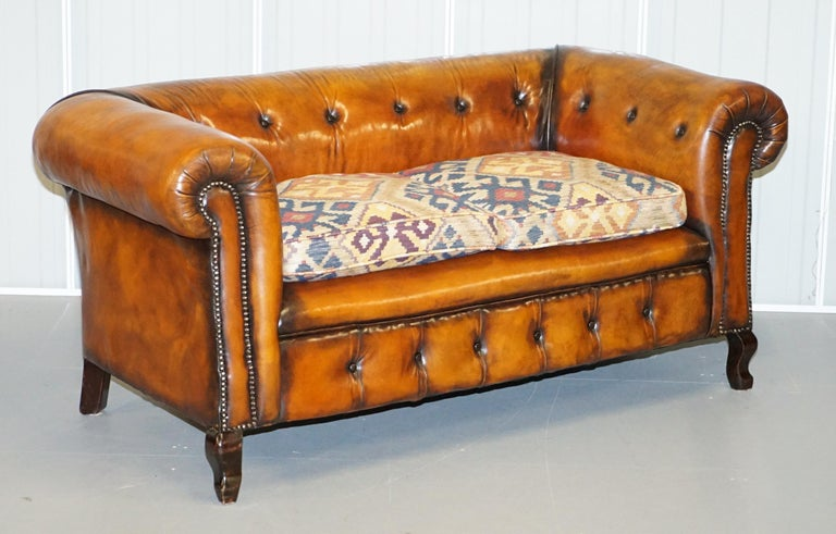Wimbledon-Furniture  Wimbledon-Furniture is delighted to offer for sale this pair of fully restored hand dyed whisky brown leather Chesterfield sofas with kilim upholstered cushions  Please note the delivery fee listed is just a guide, it covers
