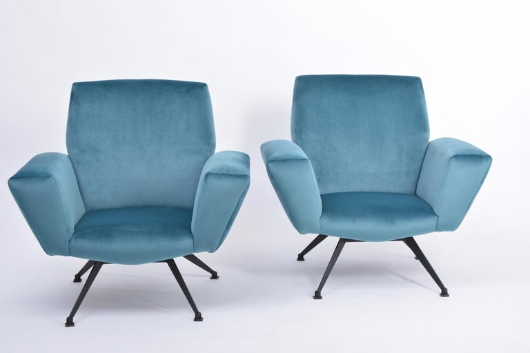 Pair of Reupholstered Teal colored Italian Lounge Chairs by Lenzi, 1950s Gorgeous pair of sculptural Mid-Century Modern lounge chairs. These chairs were produced by Italian company Lenzi in the 1950s. The model's name is 530. The base and the four