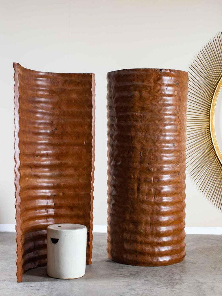 A pair of Richard Serra inspired standing sculptures made of solid teak wood designed to be seen from every angle. These sculptures, hand crafted from a single massive tree, recall the massive installations created by the artist Richard Serra using