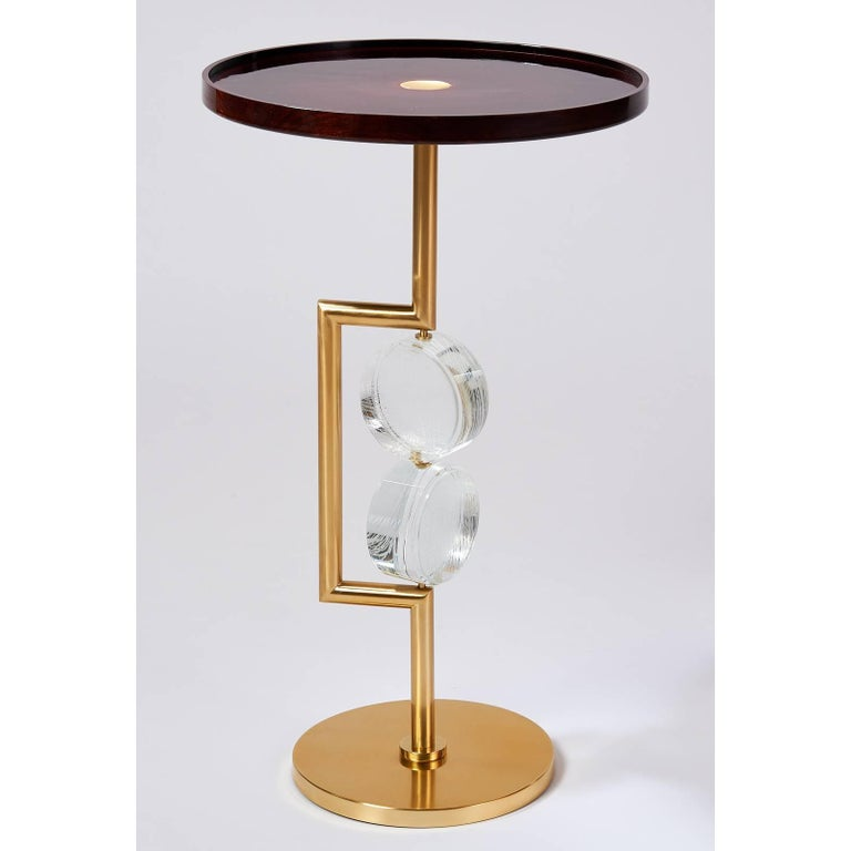 Roberto Rida(b. 1943) A pair of Bottoni side tables by Roberto Rida Beautifully clear optical glass with delicate linear etchings on both faces kinetically mounted on brass frame with polished wood top with raised rim. Signed, Limited edition of