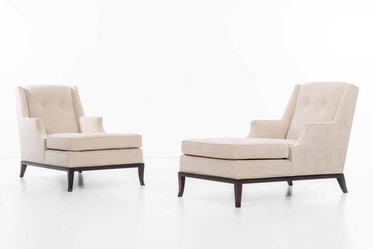 Robsjohn-Gibbings for Widdicomb pair of chaise longues. Reupholstered with Holly Hunt great plains cotton-poly fabric. Solid walnut base with splayed legs.  Measures: Seat height 16