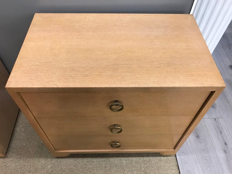 Birch and walnut small dressers on casters done in birch and walnut. They feature the classic brass drawer pulls. Made by John Widdicomb in the 1950s. No manufacturer hallmarks.