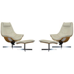 Pair of Roche Bobois Flight Swivel Cream Leather Armchairs and Ottomans