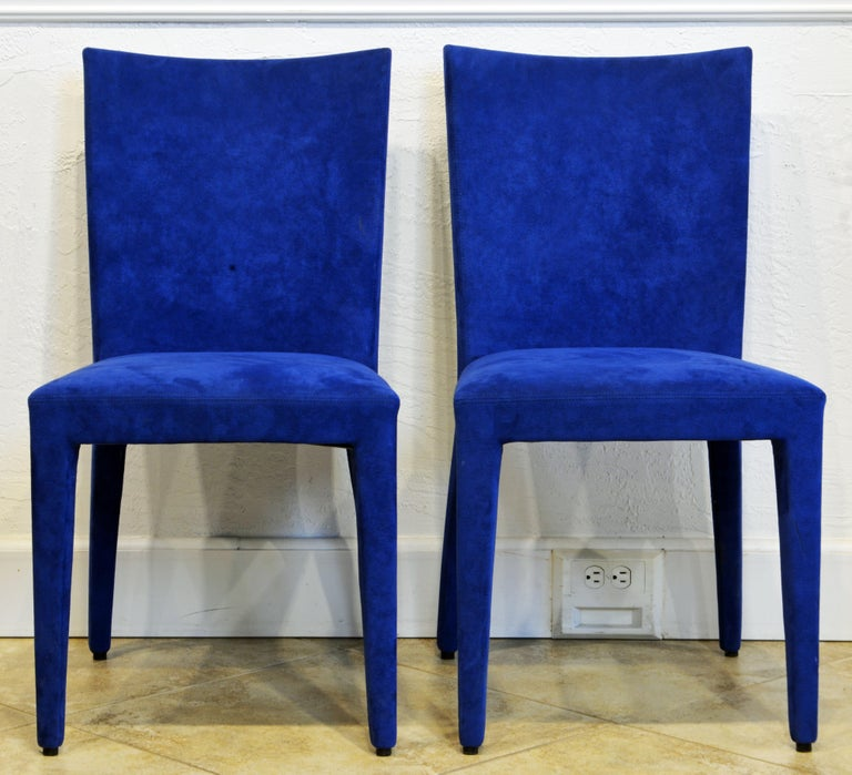 Great design and craftsmanship by legendary Roche Bobois, Paris. Covered over all in radiant blue stitched suede these side chairs make a contemporary design statement.