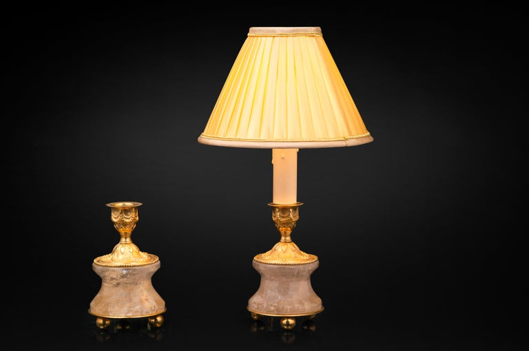 Very chic pair of rock crystal pair of lamps /candlesticks in the typic style of Louis XVI. So you can used as you want, depend of your interiors and mood. The base is carved in a single piece of rock crystal stone. The top is made in France in