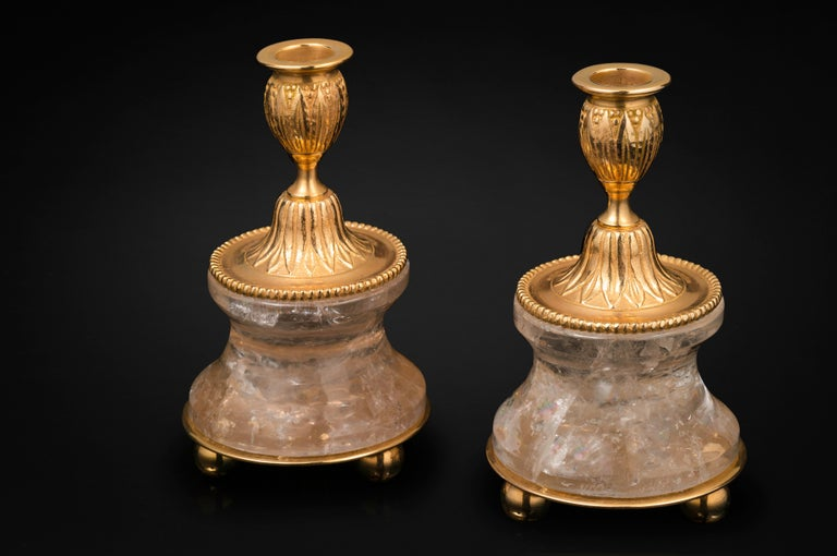 Amazing pair of rock crystal pair of lamps or candlesticks in the typic style of Louis XVI. So you can used as you want, depend of your interiors and mood. The base is carved in a single piece of rock crystal stone. The top is made in France in
