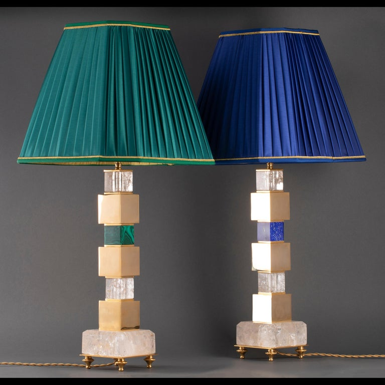 Pair of rock crystal and malachite and lapis lazuli lamps. You can have a pair with one single lamp in malachite and the other one in lapis lazuli, or also a pair in the same material. 24-karat gold-plated. Handmade in France. Design by