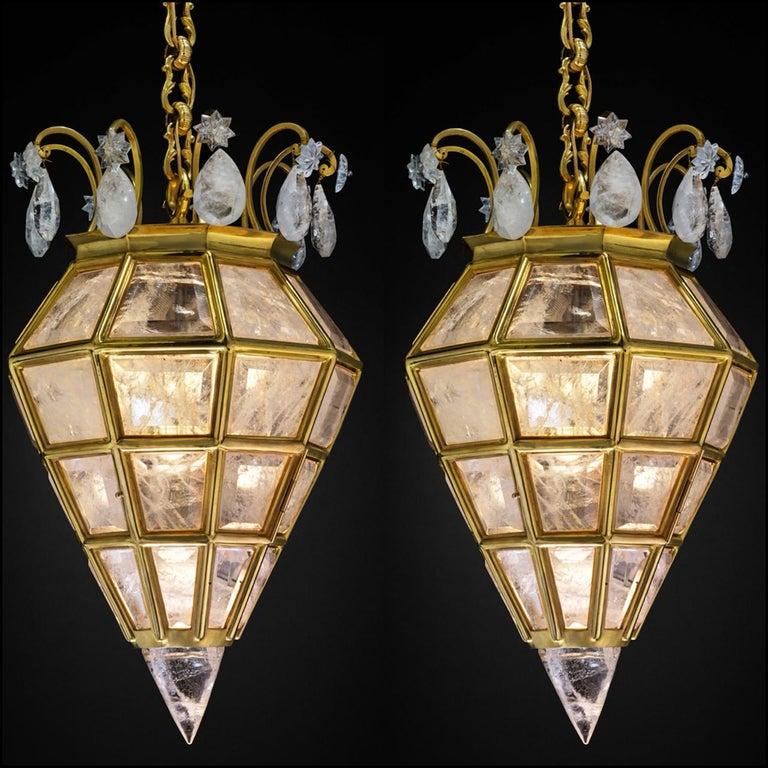 Rock crystal quartz and 24-karat gilding ormolu bronze lighting by Alexandre Vossion. This rock crystal lighting is made in France. The fixture, the chain and the canopy of this rock crystal lantern are handmade in bronze. Each workers who