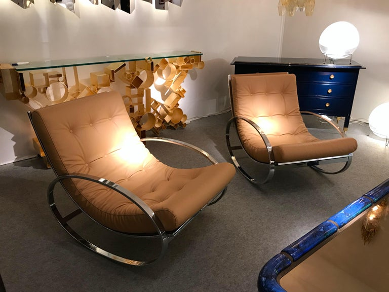 Pair of rocking chair or lounge armchairs by the designer Renato Zevi for his edition Zevi international. Metal chrome, fully upholstered with a very nice full grain leather. Famous design like Gio Ponti, Gianfranco Frattini, Cassina, Osvaldo