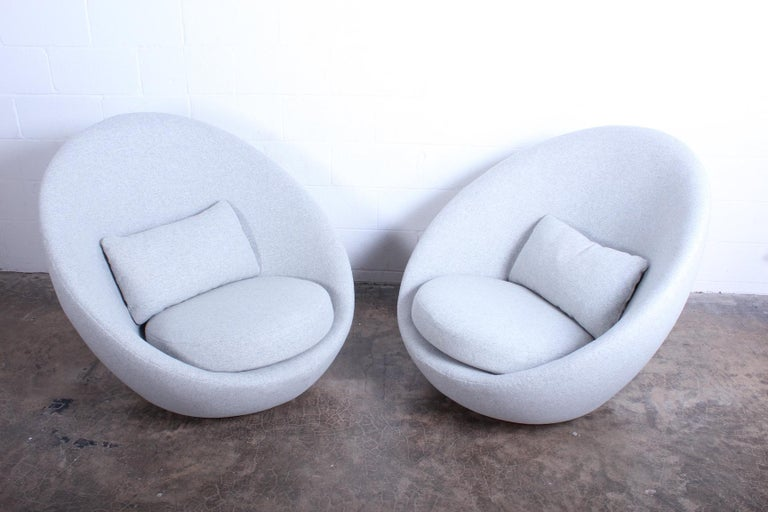 A pair of large-scale rocking swivel egg chairs by Milo Baughman for Thayer Coggin. Fully restored and upholstered in Maharam wool.