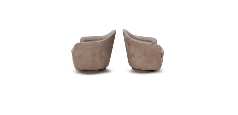 Pair of rocking swivel lounge chairs by Milo Baughman.