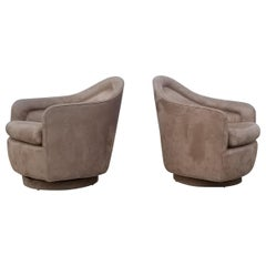 Pair of Rocking Swivel Lounge Chairs by Milo Baughman