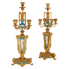 Pair of Rococo Style Porcelain and Gilt Bronze Candelabra