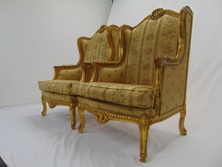 Unknown Pair of Rococo Style Vintage Wingback Gold Gilt Hand Carved Chairs For Sale