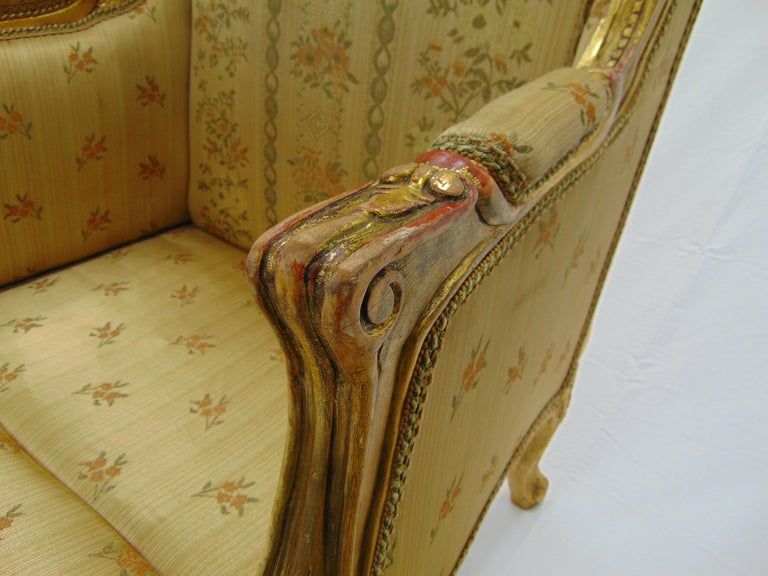 Hand-Carved Pair of Rococo Style Vintage Wingback Gold Gilt Hand Carved Chairs For Sale