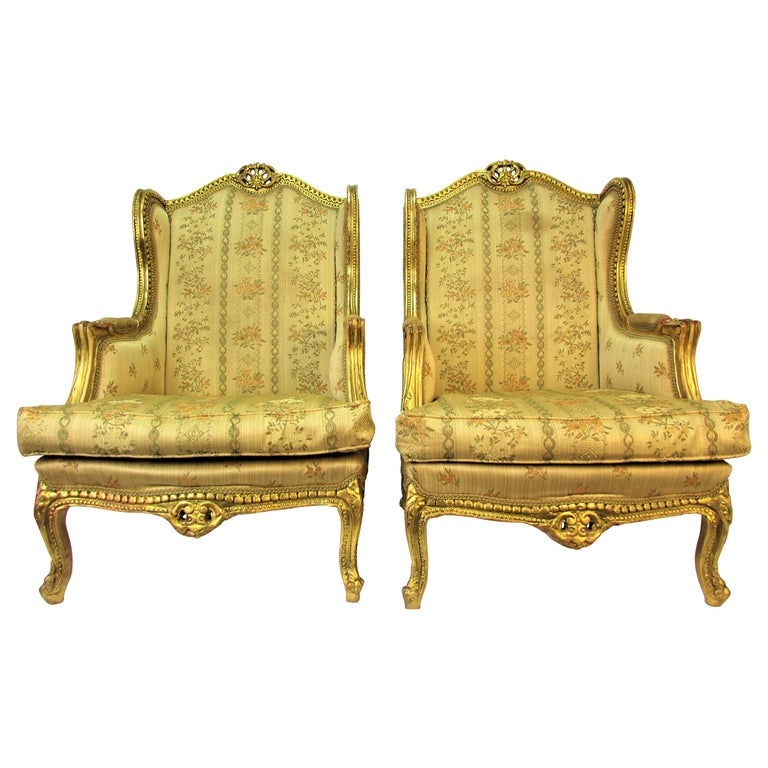 Pair of Rococo Style Vintage Wingback Gold Gilt Hand Carved Chairs For Sale