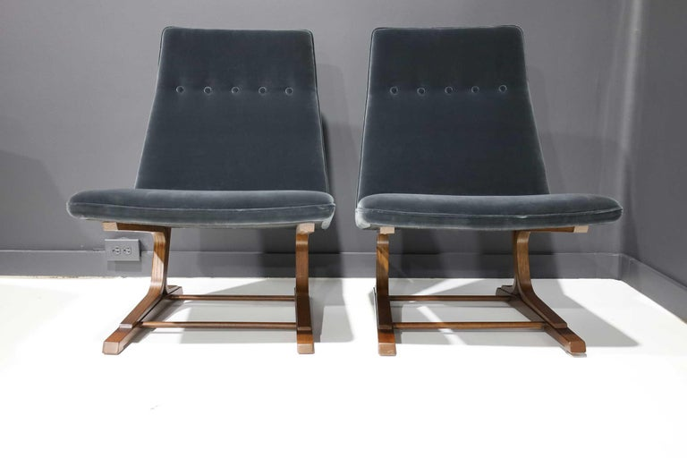 Roger Lee Sprunger for Dunbar pair of cantilever lounge chairs, model 480, oakwood base structures. Reupholstered in a Smokey blue velvet.