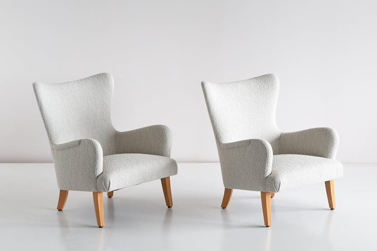 This rare pair of armchairs was designed by Rolf Engströmer for the Maria Husmodersskola in Stockholm, circa 1946. The round lines, the slanted seat and the curved, tapered sycamore legs give the design a gracious appearance.