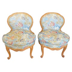 Pair of Romantic 19th Century French Carved Walnut Slipper Chairs