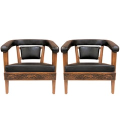 Pair of Romweber Carved Oak Lounge Chairs