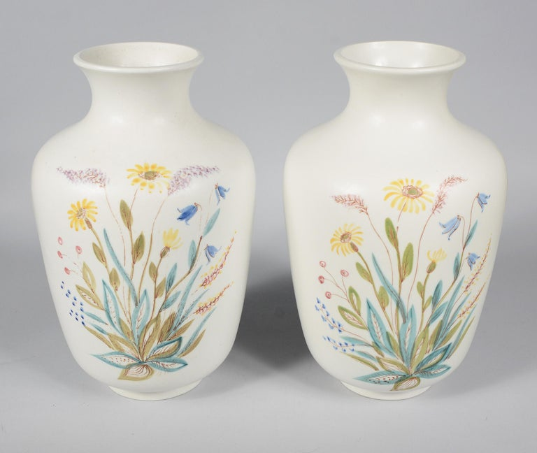 Pair of hand decorated vases by Rörstrand. These are decorated on two sides of each vase. The shape is probably a Carl-Harry Stalhane design.