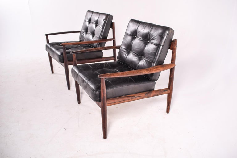 Very comfortable pair of astonishing rosewood lounge chairs by designer Grete Jalk, from the 1960s. One is stamped by Cado (previously known as France & Son) and another one is stamped by France & Son. Grete Juel Jalk was a Danish furniture designer