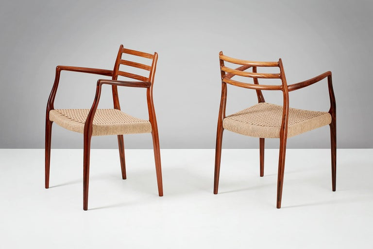 Niels Moller  Model 62 armchair, 1962.  Rosewood armchairs designed by Niels Moller for J.L. Moller Mobelfabrik, Denmark, 1962. Newly woven papercord seats.  Measures: H 80cm, D 55cm, W 56cm.
