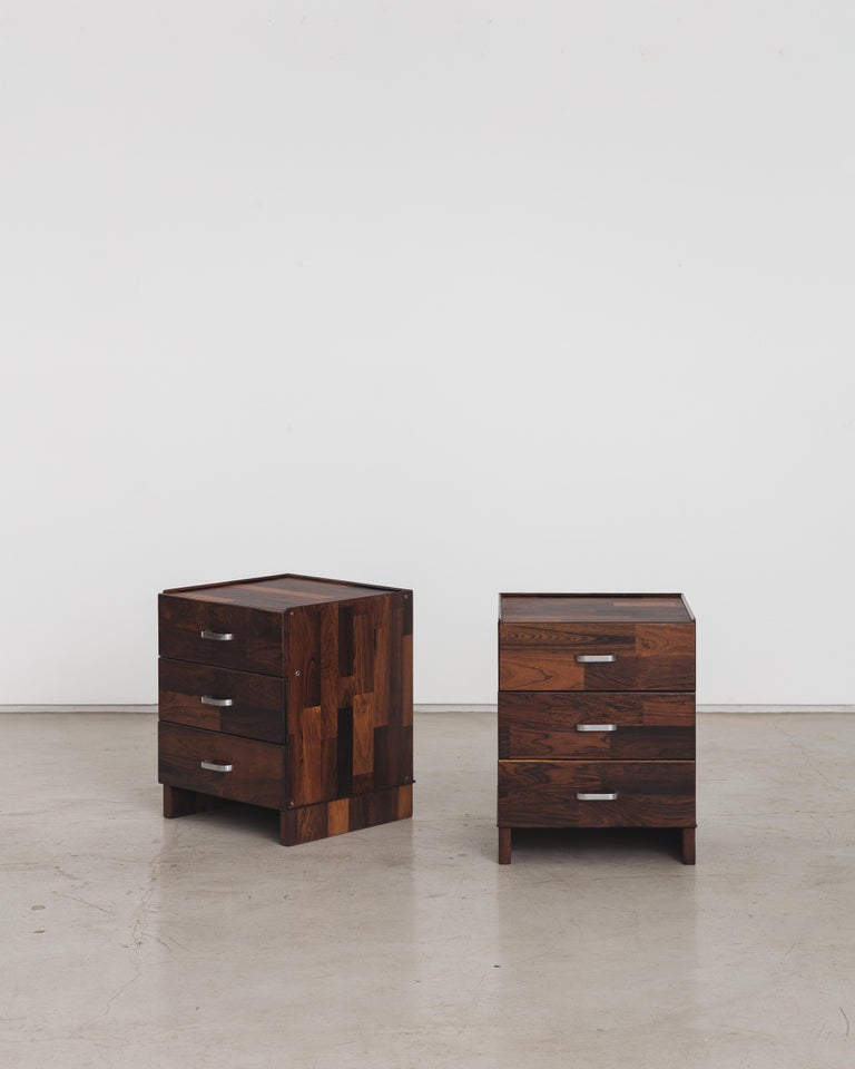 A drawer cabinet with three drawers and chrome handles designed by Jorge Zalszupin and manufactured by his company, L'Atelier. The piece is entirely covered with rectangular pieces of marquetry wood, a creative resource developed by Zalszupin. The