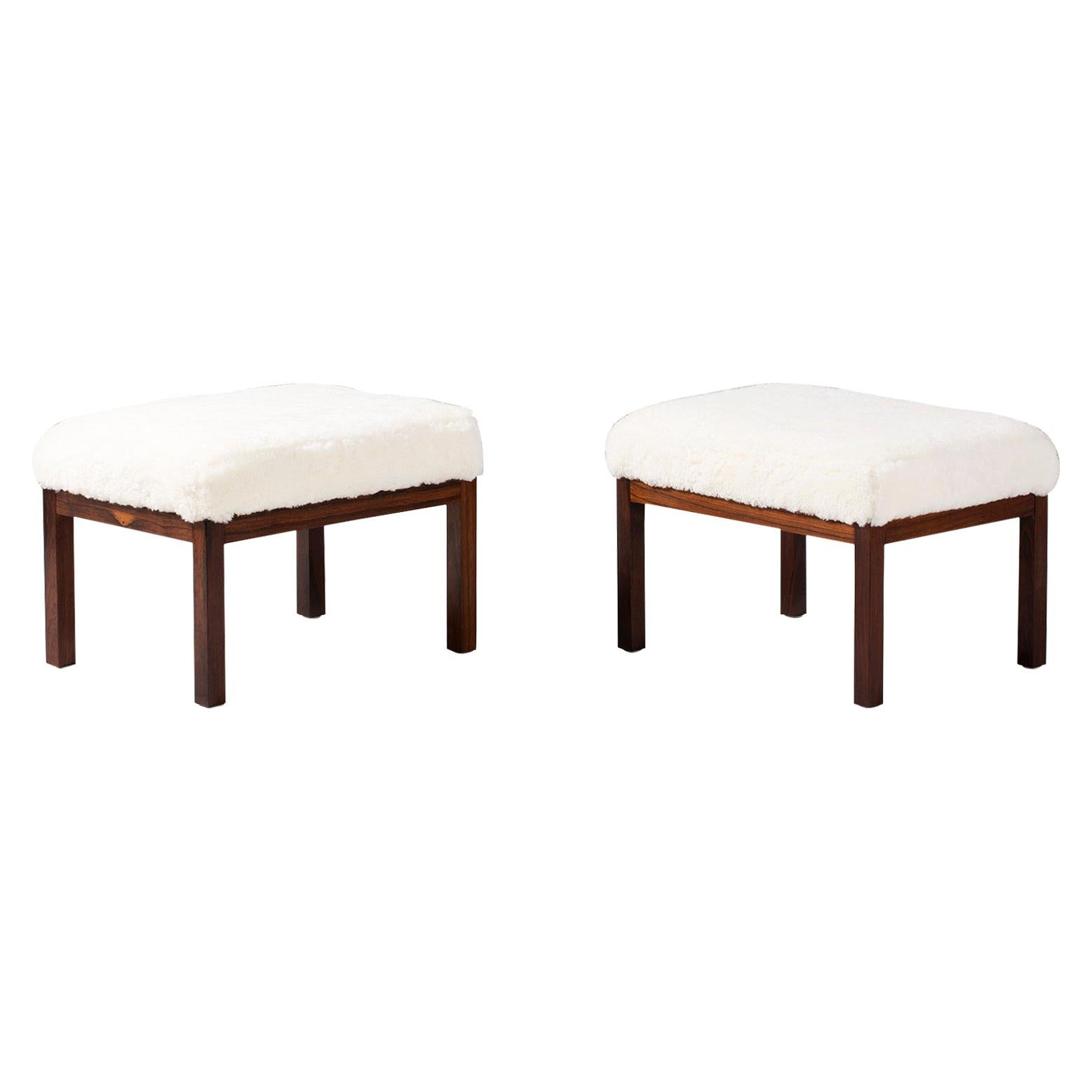 Pair of Rosewood and Sheepskin Vintage Ottomans, circa 1960s