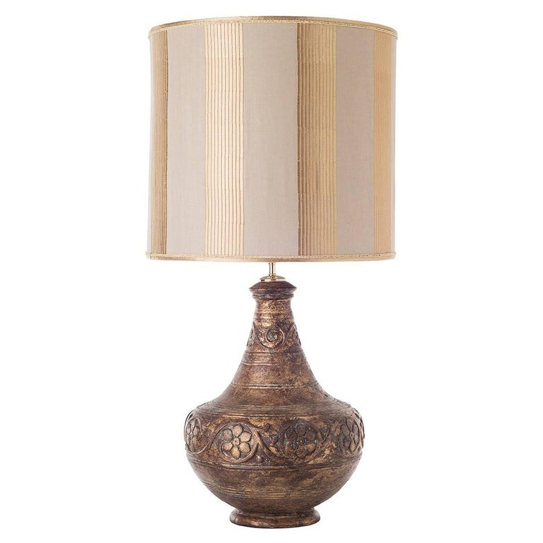 Pair of rough ceramic table lamps and shades.