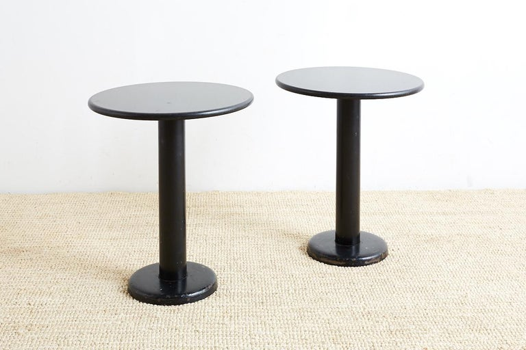 Midcentury pair of black granite drink tables featuring a round polished top. Minimalist style with an iron painted base.