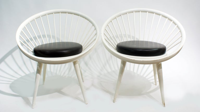Pair of midcentury circle lounge chairs by Yngve Ekström for Swedese, circa 1960. The chairs features dark brown leather seats with white lacquered beechwood structure. Yngve Ekström (1913-1988) was an architect, woodworker, and furniture designer