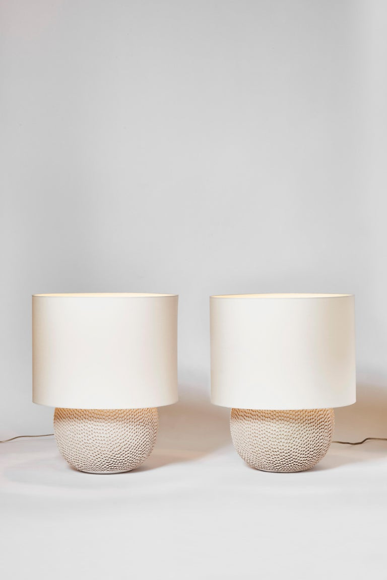 Pair of beautiful French modern table lamps made of natural color ceramic. The whole surface of the lamps are hand-pinched to create this impression of scales or feathers.