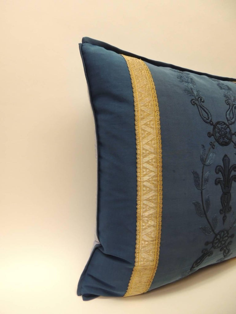 Royal blue embroidery antique textile decorative pillows 19th century royal blue embroidery has been used to create a pair of decorative square pillows. Royal blue embroidery on the antique textile of the square decorative pillows depicting flowers