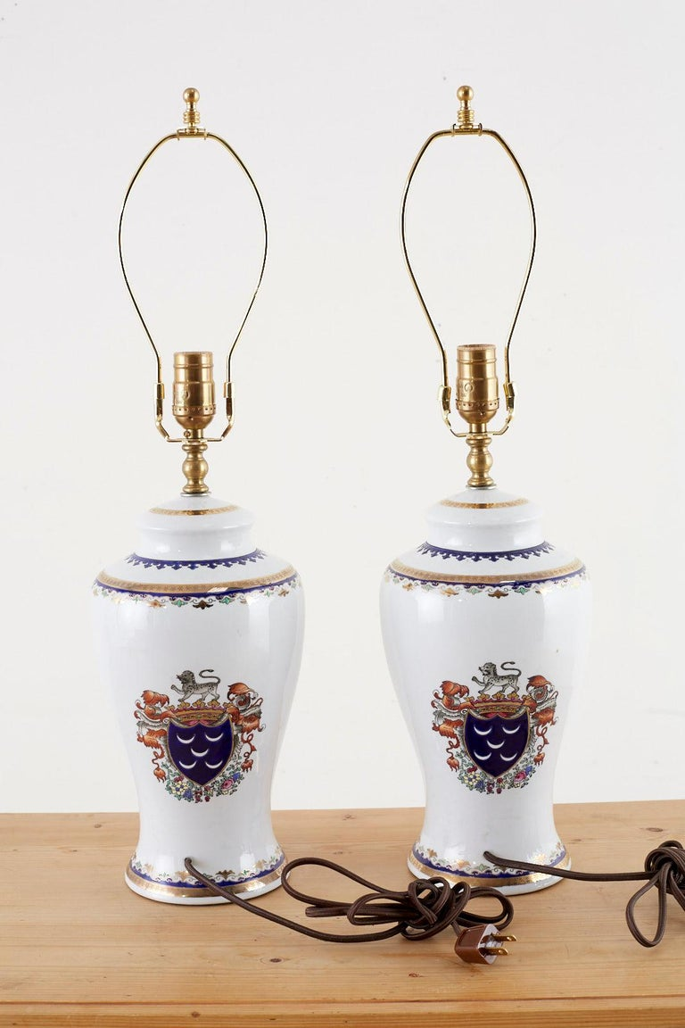 Brass Pair of Royal Coat of Arms Porcelain Jar Table Lamps For Sale
