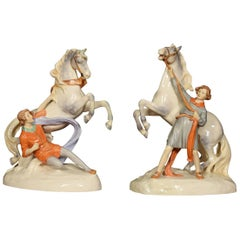 Pair of Royal Dux Figure Groups of Young Men with Horses